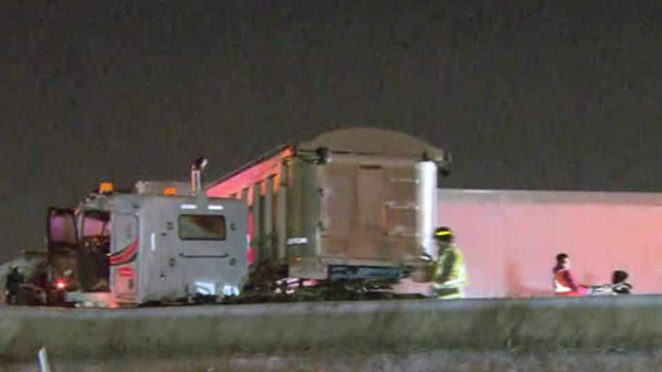Crews attend to a jackknifed tractor trailer on Highway 427 Tuesday March 19, 2019.