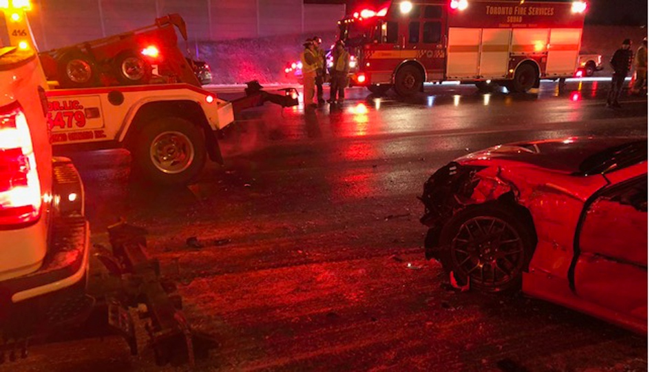 The wreckage of a vehicle is pictured following a collision in the eastbound lanes of Highway 401 near Eglinton Avenue Tuesday March 19, 2019. (Terry Devellano)