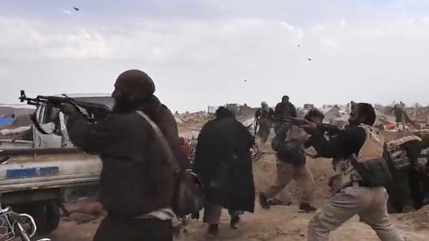 SDF rebels say ISIS encampment surrenders in eastern Syria