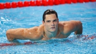 In this Aug.8, 2015 file photo, France's Florent Manaudou leaves the pool after winning the gold medal in the men's 50m freestyle final at the Swimming World Championships in Kazan, Russia. (AP Photo/Sergei Grits, File)