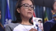 """Debbie Baptiste, mother of Colten Boushie, holds a photo of her son during a press conference on Parliament Hill in Ottawa on February 14, 2018. A film examining the case of a young Indigenous man who was killed on a farm in rural Saskatchewan will open this year's Hot Docs festival in Toronto. Organizers say Tasha Hubbard's """"nipawistamasowin: We Will Stand Up"""" will make its world premiere at the Hot Docs Canadian International Documentary Festival, which runs April 25 to May 5. A news release says the documentary """"looks at inequity and racism in the Canadian legal system"""" after the case of Colten Boushie. THE CANADIAN PRESS/Justin Tang"""