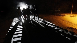 Early Sunday morning, February 26, 2017, eight migrants from Somalia cross into Canada illegally from the United States by walking down this train track into the town of Emerson, Man., where they will seek asylum at Canada Border Services Agency. A pregnant woman who walked across the border was rescued after she became trapped in a snowbank and went into labour. Emerson-Franklin Reeve Dave Carlson says the woman called 911 around 5 a.m. Saturday morning after she walked from the Minnesota side of the United States-Canada border along the railway tracks and became stuck. THE CANADIAN PRESS/John Woods
