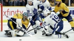 Nashville Predators goaltender Pekka Rinne (35), of Finland, blocks a shot against Toronto Maple Leafs center Nic Petan (19) in the third period of an NHL hockey game Tuesday, March 19, 2019, in Nashville, Tenn. The Predators won 3-0. (AP Photo/Mark Humphrey)