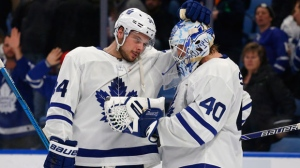 Toronto Maple Leafs forward Auston Matthews (34) and goalie Garret Sparks (40) celebrate the team's win over the Buffalo Sabres in an NHL hockey game Wednesday, March 20, 2019, in Buffalo, N.Y. (AP Photo/Jeffrey T. Barnes)