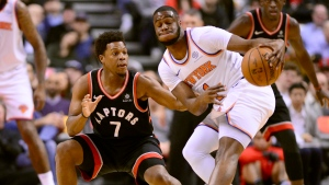 Toronto Raptors guard Kyle Lowry (7) and New York Knicks guard Emmanuel Mudiay (1) vie for control of a loose ball during first half NBA basketball action in Toronto, Monday, March 18, 2019. Kyle Lowry was ruled out of the Toronto Raptors' game Wednesday at Oklahoma City because of a sprained right ankle. THE CANADIAN PRESS/Frank Gunn