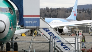 In this Monday, March 11, 2019 file photo, a Boeing 737 MAX 8 airplane being built for TUI Group sits parked in the background at right at Boeing Co.'s Renton Assembly Plant in Renton, Wash. (AP Photo/Ted S. Warren, File)