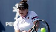 Bianca Andreescu, of Canada, returns to Irina-Camelia Begu, of Romania, during the Miami Open tennis tournament, Thursday, March 21, 2019, in Miami Gardens, Fla. (AP Photo/Lynne Sladky)