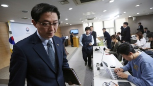 South Korean Vice Unification Minister Chun Hae-sung leaves after a press conference at the Unification Ministry in Seoul, South Korea, Friday, March 22, 2019. North Korea abruptly withdrew its staff from an inter-Korean liaison office in the North on Friday, Seoul officials said. (AP Photo/Ahn Young-joon)