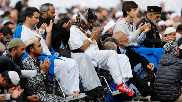 Injured victims from last week's mosque shootings pray during Friday prayers at Hagley Park in Christchurch, New Zealand, Friday, March 22, 2019. People across New Zealand observed the Muslim call to prayer Friday as the nation reflected on the moment one week ago when 50 people were slaughtered at two mosques. (AP Photo/Vincent Thian)