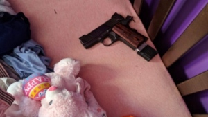 Toronto's deputy police chief says a loaded handgun was found in a child's crib during the execution of a search warrant at a home this week. (Photo: Twitter/@TPSDeputyRamer)