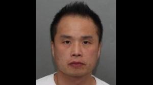 Shin Wook Kim, 45, is shown in a handout image from Toronto police.