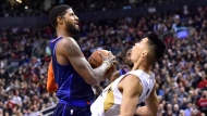 Oklahoma City Thunder forward Paul George (13) picks up an offensive foul on Toronto Raptors guard Danny Green (14) during second half NBA basketball action in Toronto on Friday, March 22, 2019. THE CANADIAN PRESS/Frank Gunn