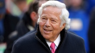 In this Jan. 20, 2019, file photo, New England Patriots owner Robert Kraft walks on the field before the AFC Championship NFL football game in Kansas City, Mo. Florida prosecutors have offered a plea deal to Kraft and other men charged with paying for illicit sex at a massage parlor. The Palm Beach State Attorney confirmed Tuesday, March 19, 2019, it has offered Kraft and 24 other men charged with soliciting prostitution the standard diversion program offered to first-time offenders.  (AP Photo/Charlie Neibergall, File)