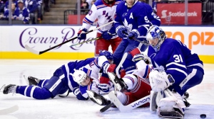 Toronto Maple Leafs goaltender Frederik Andersen (31) fails to stop the puck from going into the net during third period NHL hockey action against the New York Rangers, in Toronto on Saturday, March 23, 2019. THE CANADIAN PRESS/Frank Gunn