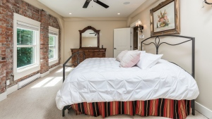 "A bedroom in a house at 39623 Old Yale Road in Abbotsford, B.C. is shown in a handout photo. An online auction for a luxury home in nearby Abbotsford, B.C., is drawing attention for its novel approach, which some observers say has potential to inspire new sales even if it doesn't have any notable impact on the housing landscape. Bidding opens Tuesday on the 12-bedroom, 10-bath restored train power station listed as the ""Sumas Powerhouse,"" which previously sold for $5 million. THE CANADIAN PRESS/HO-Concierge Auctions"