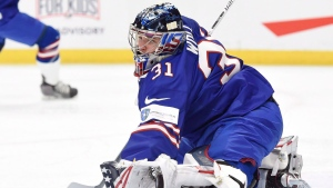 Goaltender Joseph Woll (31) of United States makes a glove save against Sweden during second period semifinal IIHF World Junior Championship hockey action in Buffalo, N.Y. on Thursday, January 4, 2018. THE CANADIAN PRESS/Nathan Denette