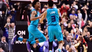 Charlotte Hornets guard Jeremy Lamb (3) celebrates his game-winning basket against the Toronto Raptors with teammate Devonte' Graham, left, during second half NBA basketball action in Toronto on Sunday, March 24, 2019. THE CANADIAN PRESS/Frank Gunn