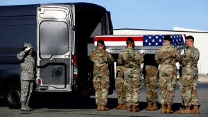 A U.S. Army carry team places a transfer case containing the remains of Spc. Joseph P. Collette into a vehicle, Sunday, March 24, 2019, at Dover Air Force Base, Del. According to the Department of Defense, Collette, of Lancaster, Ohio, was killed March 22 while involved in combat operations in Kunduz Province, Afghanistan. (AP Photo/Patrick Semansky)