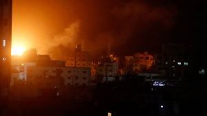 An explosion caused by Israeli airstrikes is seen from Hamas security building in Gaza City, Monday, March 25, 2019. Israeli forces on Monday struck targets across the Gaza Strip in response to a surprise rocket attack from the Palestinian territory, as the military beefed up troops and rocket-defense systems in anticipation of a new round of heavy fighting with the Islamic militant Hamas group. (AP Photo/Adel Hana)