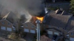 A fire at a home in Mississauga on March 25, 2019 is seen.