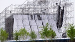 A collapsed stage is shown at Downsview Park in Toronto on Saturday, June 16, 2012. One person is confirmed dead and another injured after the main stage partially collapsed before a Radiohead concert. THE CANADIAN PRESS/Nathan Denette