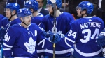 Toronto Maple Leafs centre John Tavares (91) celebrates his fourth goal of the game against the Florida Panthers with teammates including Auston Matthews (34) during third period NHL hockey action in Toronto on Monday, March 25, 2019. THE CANADIAN PRESS/Nathan Denette