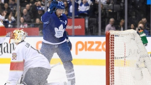Toronto Maple Leafs centre John Tavares (91) celebrates his third goal of the game as Florida Panthers goaltender Roberto Luongo (1) looks on during second period NHL hockey action in Toronto on Monday, March 25, 2019. THE CANADIAN PRESS/Nathan Denette