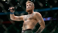 In this Oct. 6, 2018, file photo, Conor McGregor walks in the cage before fighting Khabib Nurmagomedov in a lightweight title mixed martial arts bout at UFC 229 in Las Vegas. (AP Photo/John Locher, File)