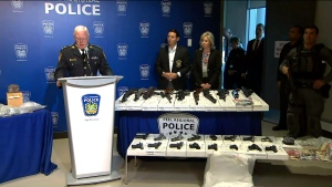 Peel Regional Police Chief Chris McCord is shown alongside some of the 26 firearms seized as part of a major bust.