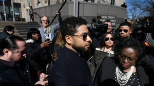 Actor Jussie Smollett leaves Cook County Court after his charges were dropped Tuesday, March 26, 2019, in Chicago. (AP Photo/Paul Beaty)