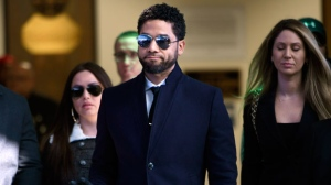 "Actor Jussie Smollett gestures as he leaves Cook County Court after his charges were dropped Tuesday, March 26, 2019, in Chicago. Prosecutors on Tuesday abruptly dropped all charges against Smollett, defense attorneys said, apparently abandoning the case barely five weeks after the ""Empire"" actor was accused of lying to police about being the target of a racist, anti-gay attack in downtown Chicago. (AP Photo/Paul Beaty)"