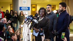 In this Tuesday, March 26, 2019, file photo, actor Jussie Smollett, right, listens as his attorney, Patricia Brown Holmes, speaks to reporters at the Leighton Criminal Courthouse after prosecutors dropped all charges against him. Brown Holmes is now trying to shift attention back to two brothers who told police they were paid to help stage an attack on Smollett. (Ashlee Rezin/Chicago Sun-Times via AP, File)
