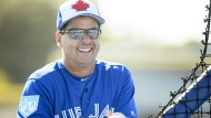 Toronto Blue Jays manager Charlie Montoyo gets ready to throw a batting practice session during baseball spring training in Dunedin, Fla., on Sunday, February 17, 2019. THE CANADIAN PRESS/Nathan Denette