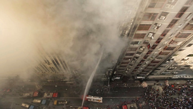 Workers jump to their deaths as Dhaka office block fire kills seven