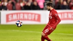 Toronto FC's Alejandro Pozuelo chips over the keeper to score on a penalty shot against New York City during second half MLS action in Toronto, Friday, March 29, 2019. THE CANADIAN PRESS/Frank Gunn