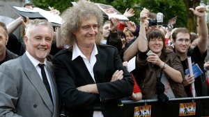 "FILE - In this Sept. 13, 2010 file photo, members of the rock band Queen, Roger Taylor, front left, and Brian May, front right, pose during a meeting with fans to promote the musical ""We Will Rock You"" in Berlin, Germany. (AP Photo/Michael Sohn, File)"
