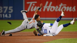 Baltimore Orioles shortstop Richie Martin (1) is tagged out at second base by Toronto Blue Jays shortstop Freddy Galvis (16) during fourth inning American League baseball action in Toronto on Monday, April 1, 2019. THE CANADIAN PRESS/Nathan Denette
