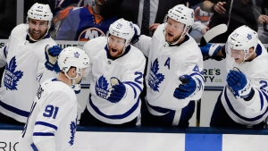 Toronto Maple Leafs' John Tavares (91) celebrates with teammates Nazem Kadri (43), Connor Brown (28), Morgan Rielly (44) and Travis Dermott (23) after scoring a goal during the third period of an NHL hockey game against the New York Islanders Monday, April 1, 2019, in Uniondale, N.Y. The Maple Leafs won 2-1. (AP Photo/Frank Franklin II)