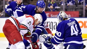 Toronto Maple Leafs defenceman Ron Hainsey (2) battles Carolina Hurricanes right wing Nino Niederreiter (21) battle in front of Toronto Maple Leafs goaltender Garret Sparks (40) during third period NHL hockey action in Toronto on Tuesday, April 2, 2019. THE CANADIAN PRESS/Frank Gunn