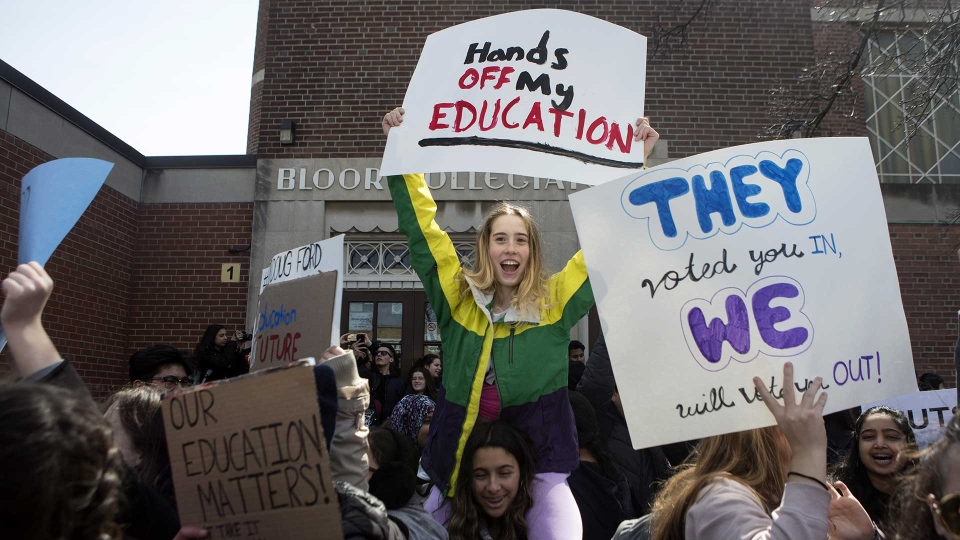 Students from a Toronto high school protest during a walkout on Thursday April, 4, 2019. Students across Ontario staged a walkout to protest against changes to the province's education system. THE CANADIAN PRESS/Chris Young