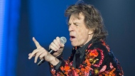 """FILE - In this Oct. 22, 2017 file photo, Mick Jagger of the Rolling Stones performs during the concert of their 'No Filter' Europe Tour 2017 at U Arena in Nanterre, outside Paris, France. The Rolling Stones are postponing their latest tour so Jagger can receive medical treatment.  The band announced Saturday, March 30, 2019 that Jagger """"has been advised by doctors that he cannot go on tour at this time."""" The band added that Jagger """"is expected to make a complete recovery so that he can get back on stage as soon as possible."""" (AP Photo/Michel Euler, File)"""