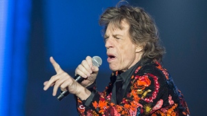 "FILE - In this Oct. 22, 2017 file photo, Mick Jagger of the Rolling Stones performs during the concert of their 'No Filter' Europe Tour 2017 at U Arena in Nanterre, outside Paris, France. The Rolling Stones are postponing their latest tour so Jagger can receive medical treatment.  The band announced Saturday, March 30, 2019 that Jagger ""has been advised by doctors that he cannot go on tour at this time."" The band added that Jagger ""is expected to make a complete recovery so that he can get back on stage as soon as possible."" (AP Photo/Michel Euler, File)"