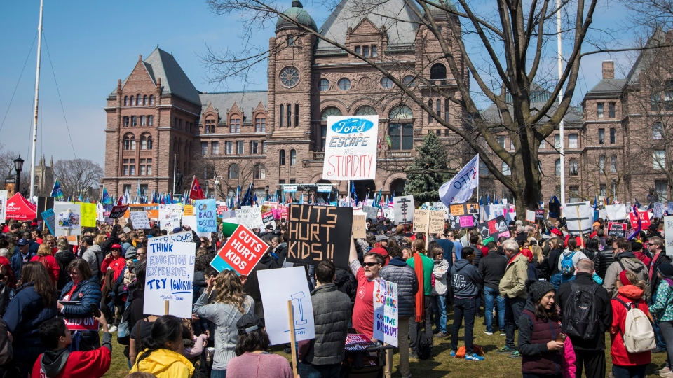 A large crowd gathers at Queen's Park to protest the provincial government's recently announced changes to education during the Rally for Education event in Toronto on Saturday, April 6, 2019. THE CANADIAN PRESS/ Tijana Martin