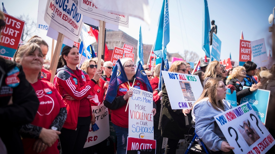 A large crowd gathers at Queen's Park to protest the provincial government's recently announced changes to education during the Rally for Education in Toronto on Saturday, April 6, 2019. THE CANADIAN PRESS/ Tijana Martin