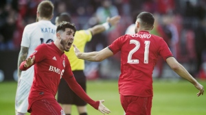 Toronto FC midfielder Jonathan Osorio (21) celebrates his goal against the Chicago Fire with teammate Alejandro Pozuelo, left, during second half MLS soccer action in Toronto, Saturday, April 6, 2019. THE CANADIAN PRESS/Frank Gunn