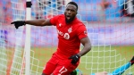 Toronto FC forward Jozy Altidore (17) celebrates his goal against Chicago Fire goalkeeper David Ousted during first half MLS soccer action in Toronto, Saturday, April 6, 2019. THE CANADIAN PRESS/Frank Gunn