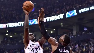 Toronto Raptors forward Pascal Siakam (43) shoots over Miami Heat centre Bam Adebayo (13) during first half NBA basketball action in Toronto on Sunday, April 7, 2019. THE CANADIAN PRESS/Frank Gunn