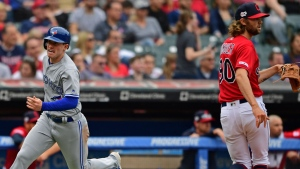 Toronto Blue Jays' Billy McKinney scores on a RBI-single by Danny Jansen as Cleveland Indians relief pitcher Adam Cimber watches in the eighth inning of a baseball game, Sunday, April 7, 2019, in Cleveland. The Indians won 3-1. (AP Photo/David Dermer)