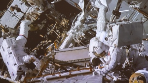 Canadian astronaut David Saint-Jacques, right, and American astronaut Anne McClain take part in a spacewalk as seen in the livefeed from the Canadian Space Agency headquarters Monday, April 8, 2019 in St. Hubert, Que.THE CANADIAN PRESS/Ryan Remiorz