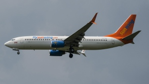 A Sunwing Boeing 737-800 passenger plane prepares to land at Pearson International Airport in Toronto on Wednesday, August 2, 2017. The Canadian Transportation Agency has ordered Sunwing Airlines Inc. to compensate more than 16,000 passengers and pay a $694,500 fine due to widespread service problems sparked by an ice storm that hit Toronto one year ago. THE CANADIAN PRESS/Christopher Katsarov
